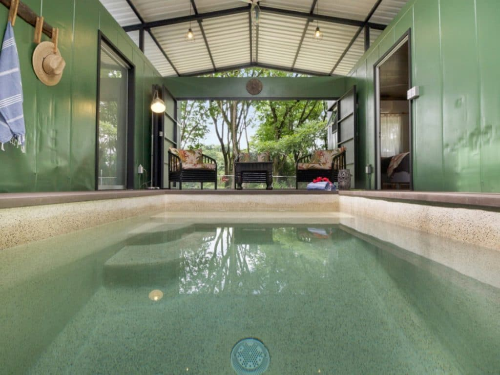 Plunge pool in middle of tiny home atrium