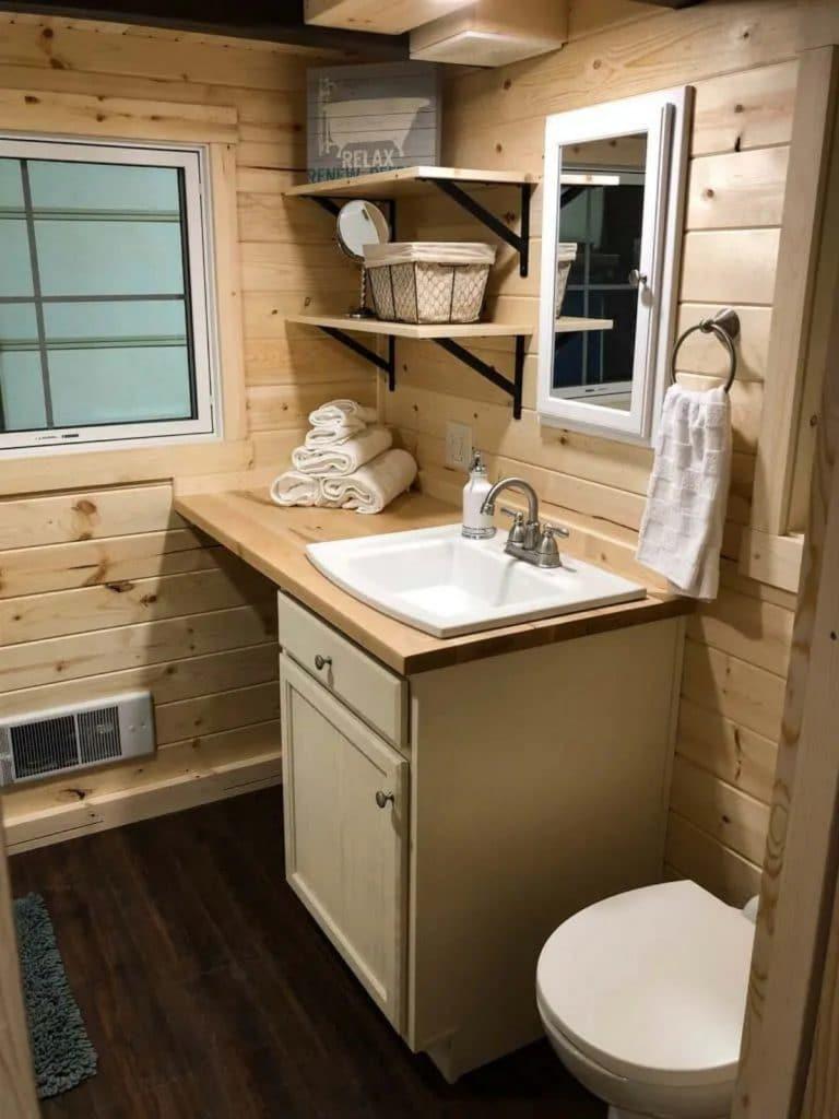 Blonde wood vanity with white sink