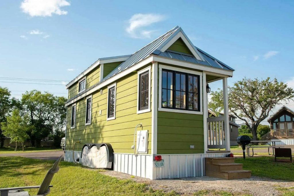 Green tiny house with porch