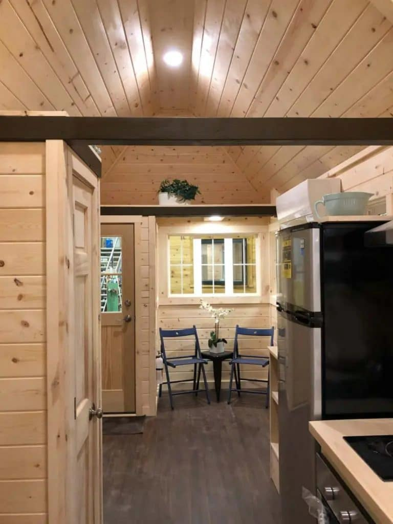 View into dining nook with triple windows