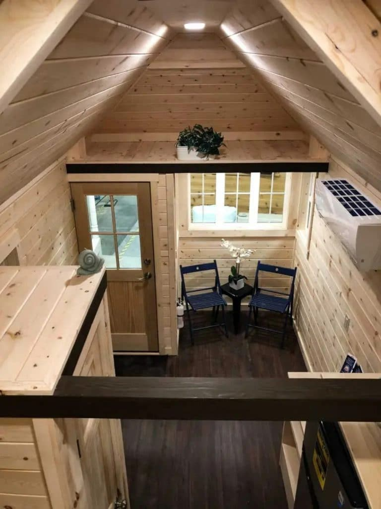 View down from loft into rustic living room
