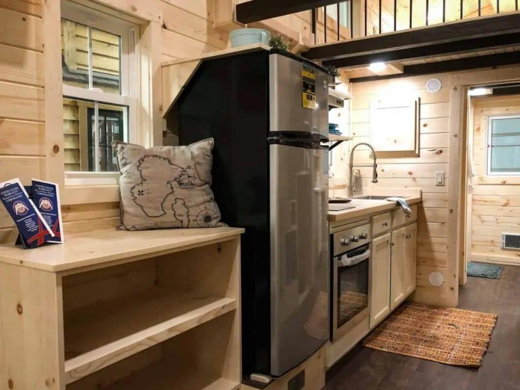 Wood shelf by stainless steel refrigertor