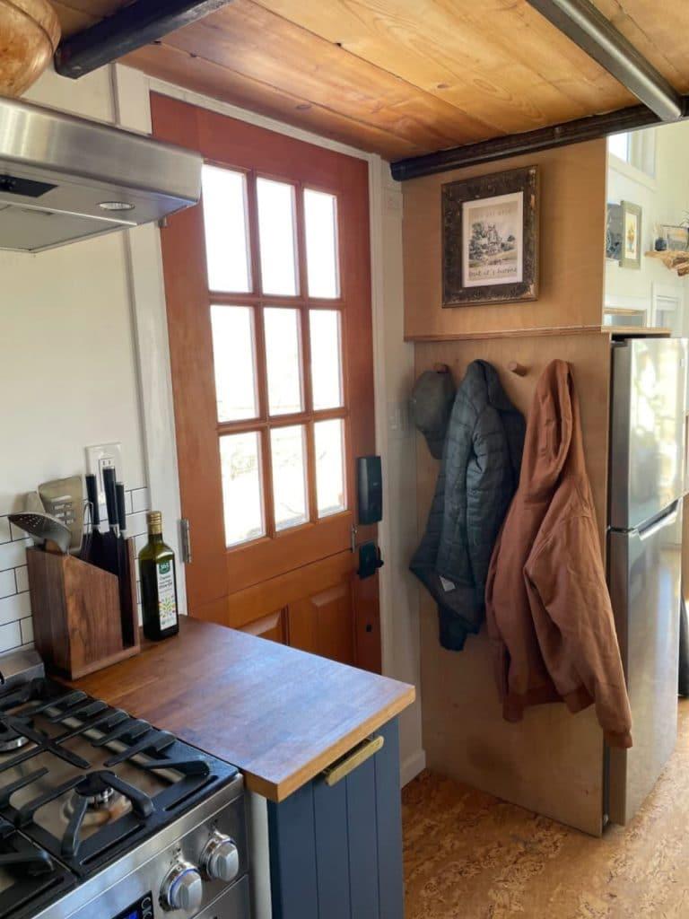 Interior front door by kitchen counter