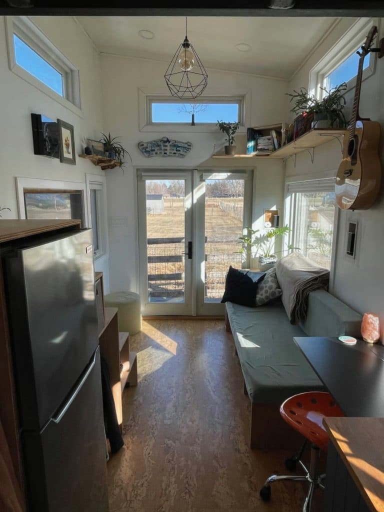 View into living room with picture windows at end