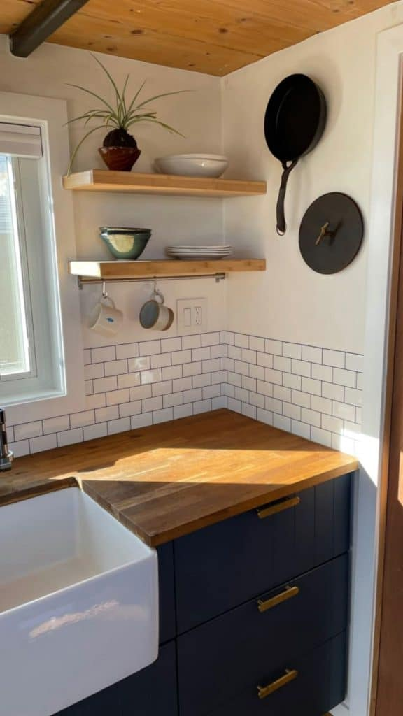 Corner of kitchen counter with butcher block counter and white tile behind