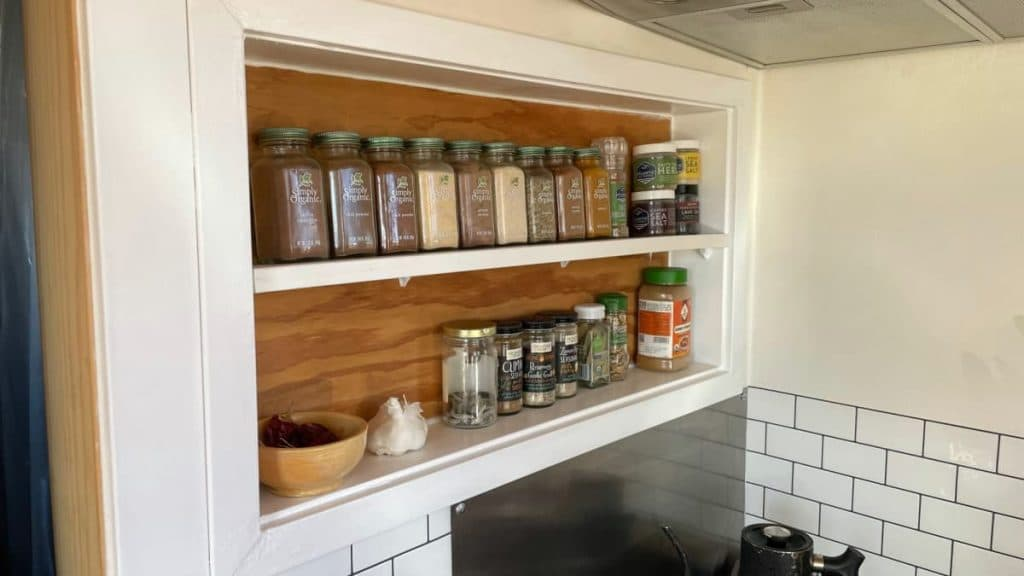 Spice shelf above stove in wall