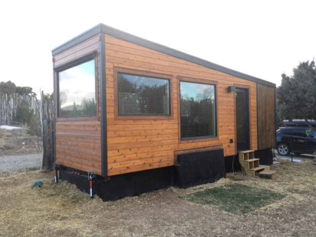 Brown home on wheels with black trim