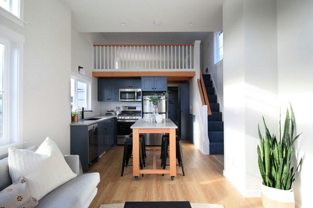 View into tiny house kitchen with island