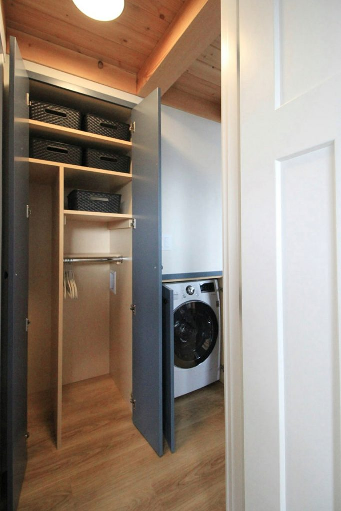 Open doors with closet and laundry unit
