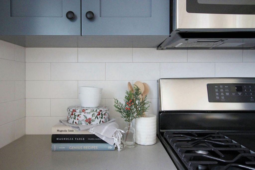 Kitchen counter below blue cabinets