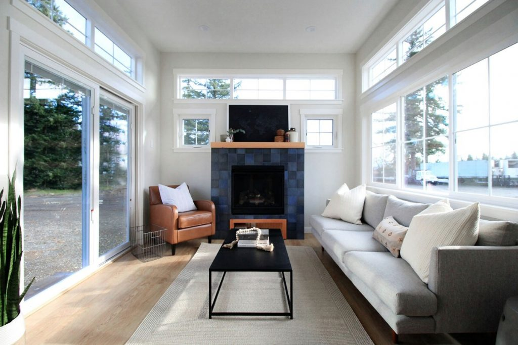 Living room in tiny house with large glass doors
