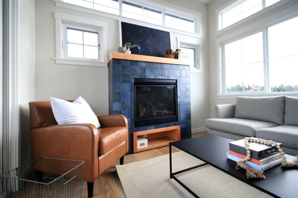 Living room wit blue stone fireplace