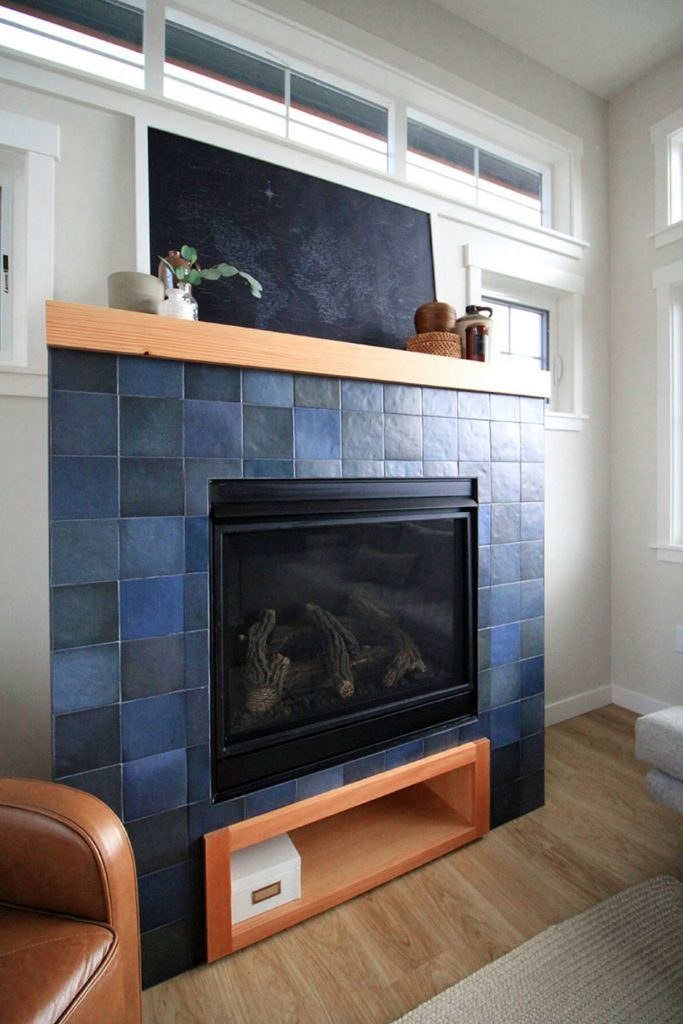 Blue stone fireplace with wood accents