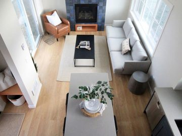 Overhead shot of living room with grey sofa and blue fireplace