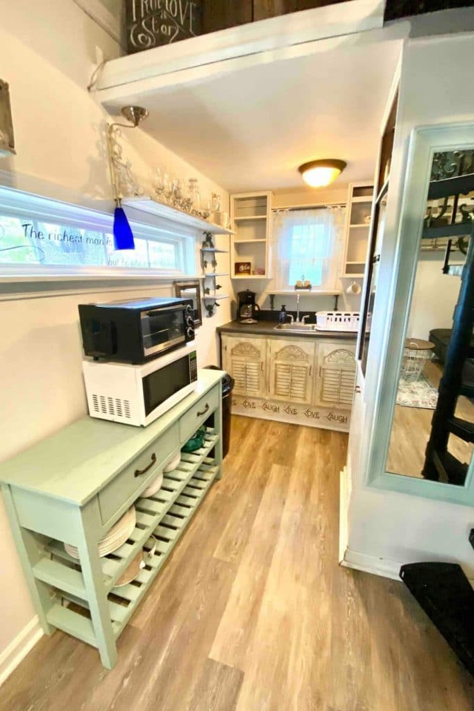 Kitchen with green table holding microwave and toaster