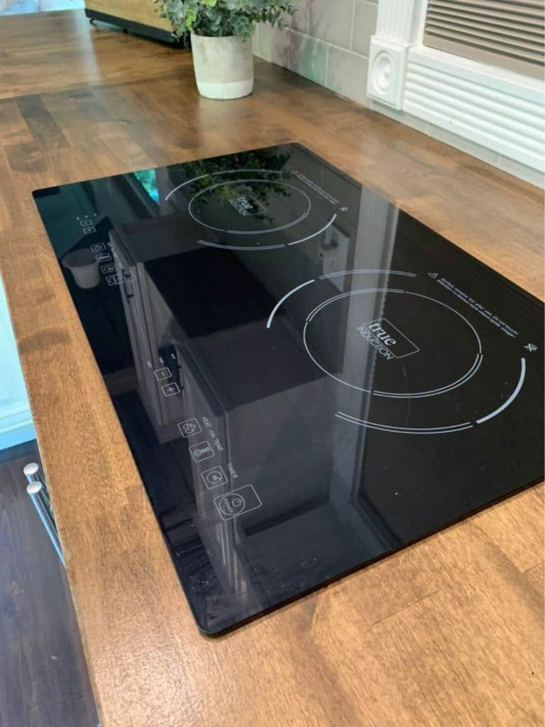 Induction cooktop in butcher block counter