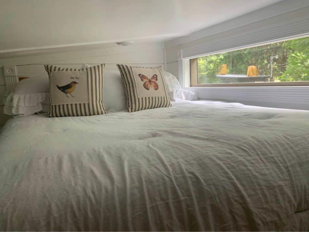 Loft bedroom with long window