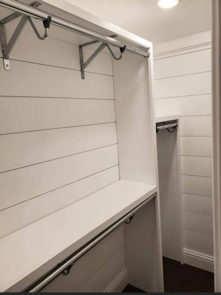 White closet with shiplap walls