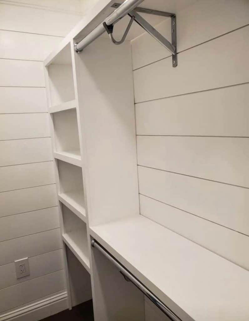 Shiplap white walls with white shelves