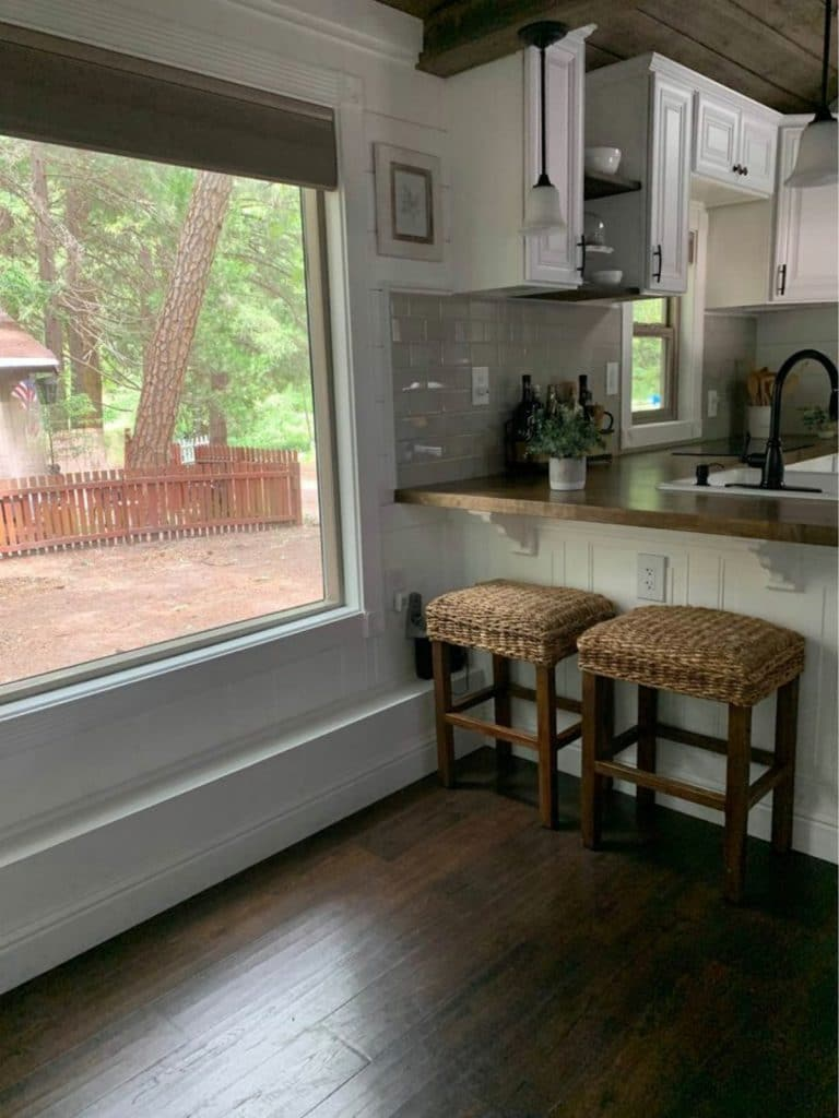 Large window by kitchen counter with stools
