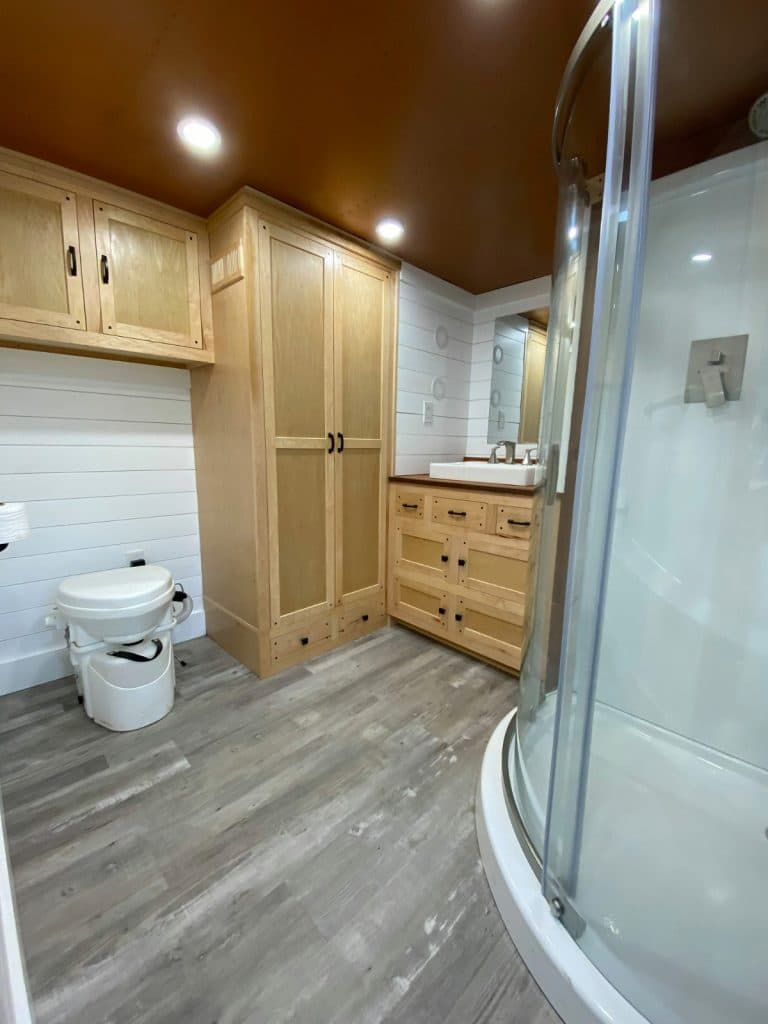 Large open space under cabinets in tiny bathroom