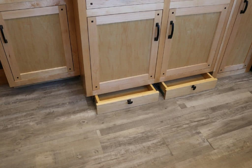 Cabinets with two drawers below half open