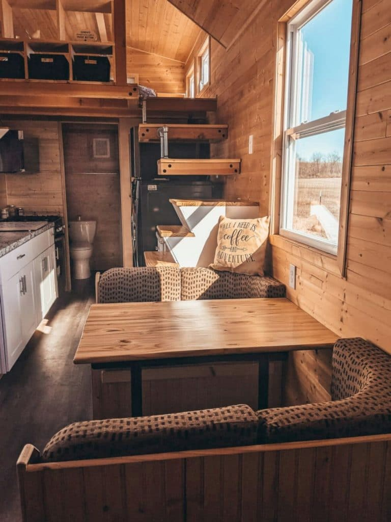 Behind tiny home dinette set