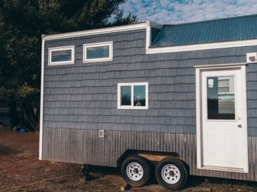 Tiny home with grey siding and white trim