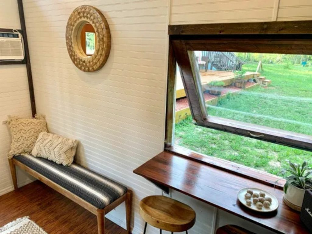 Window open above table with stools