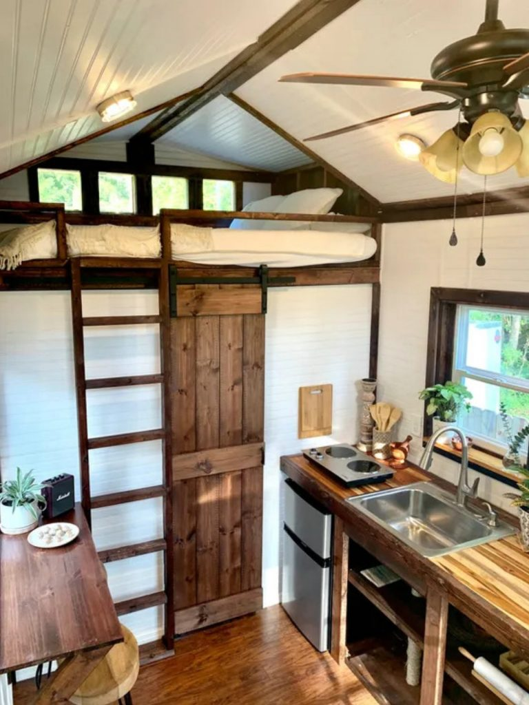 Tiny house living space view into loft