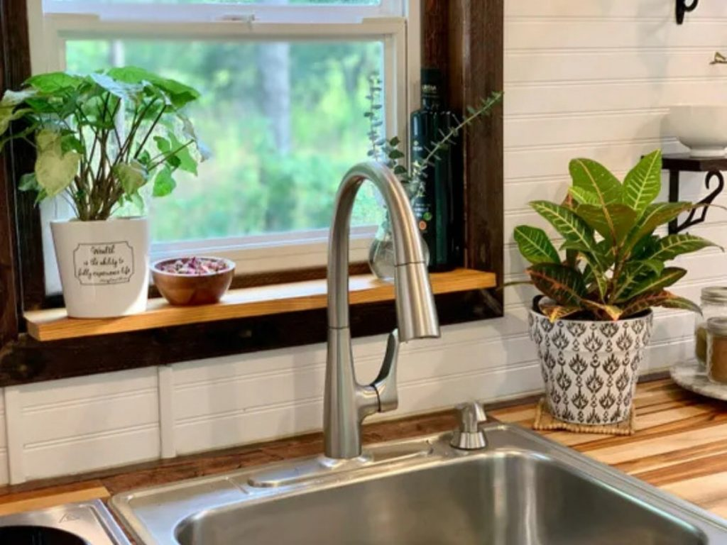 Deep stainless steel sink in front of window