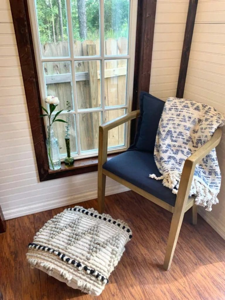 Blue chair draped with chevron blanket
