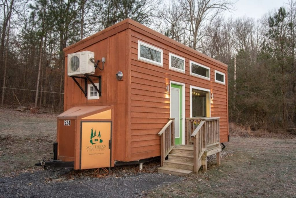 Front of brown tiny home with small porch