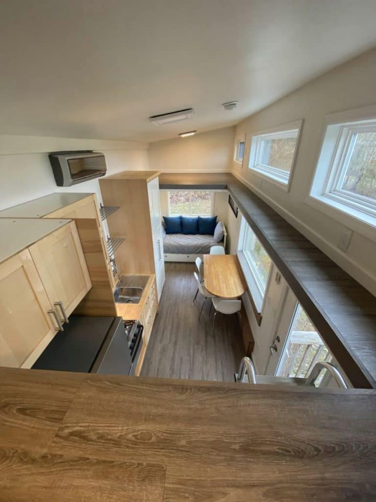 Loft and railing above main floor of tiny home