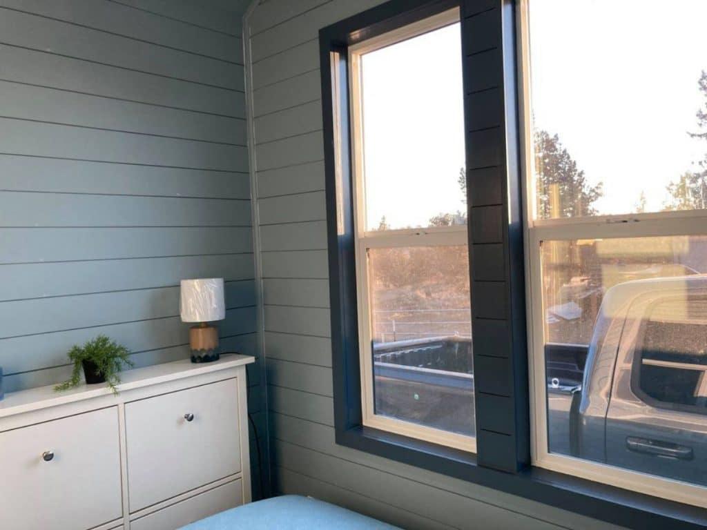 Window beside bed in tiny bedroom