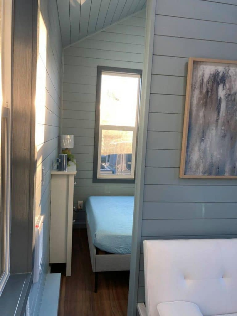 View into tiny house bedroom