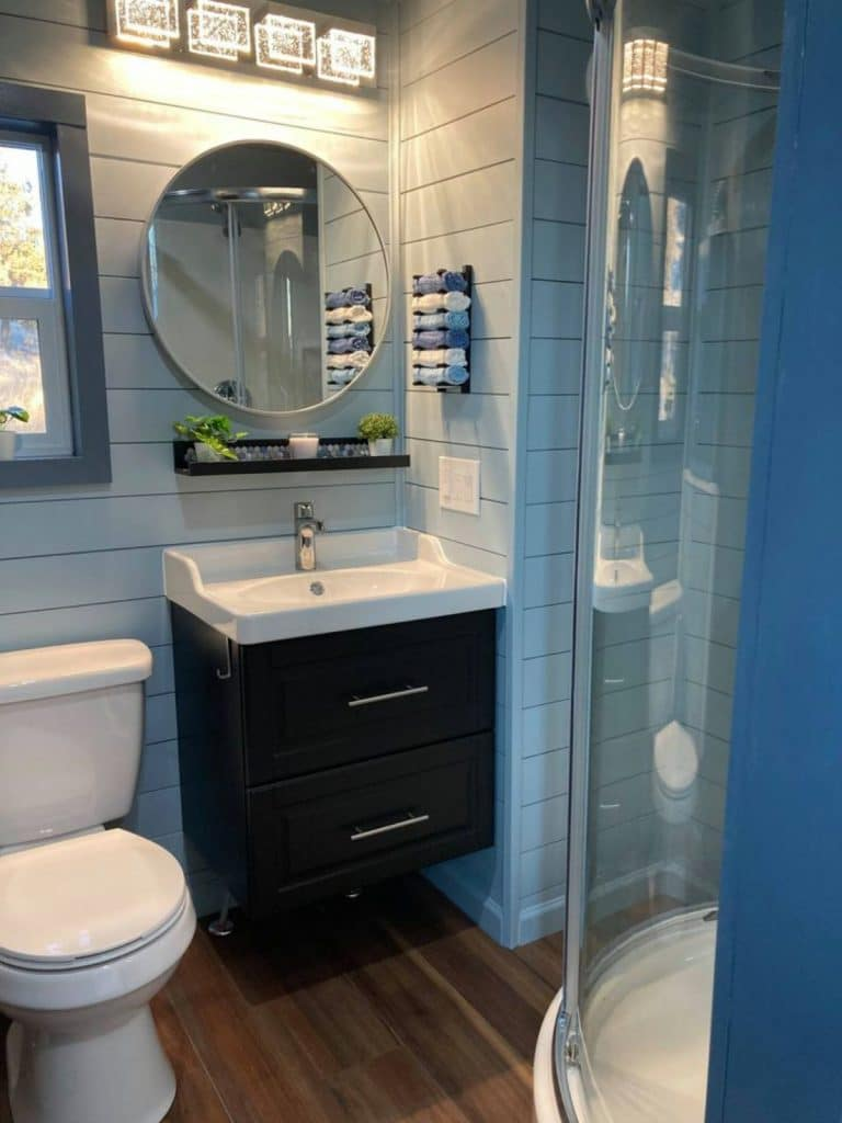 Bathroom with dark wood vanity and white sink