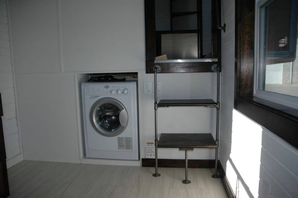 White wall with washer and dryer built in