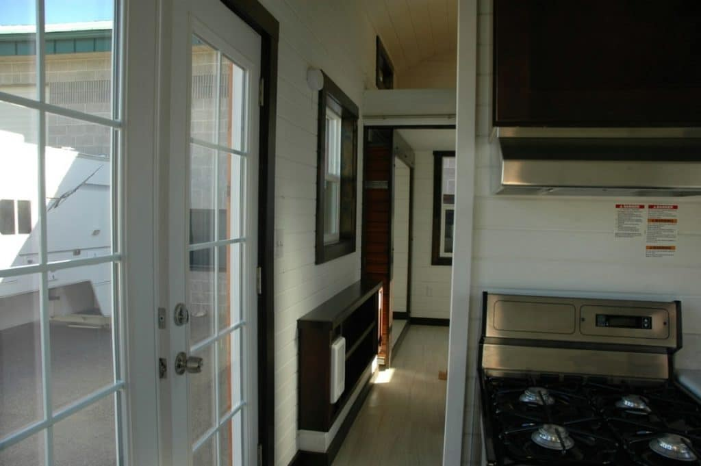Glass paned white front door leading to hall