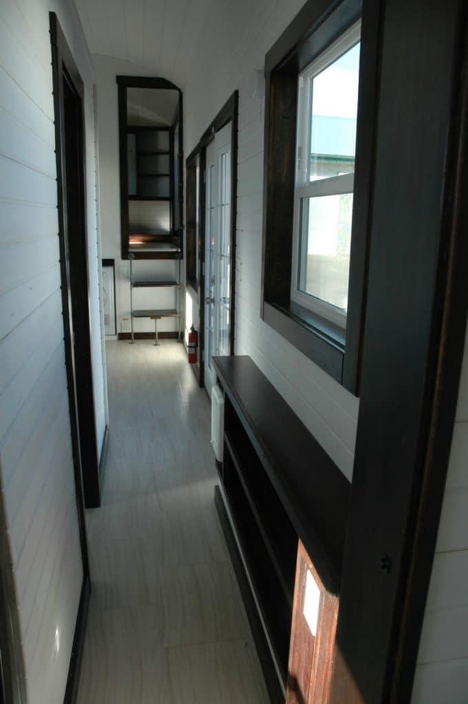 View down tiny hall with dark brown trim