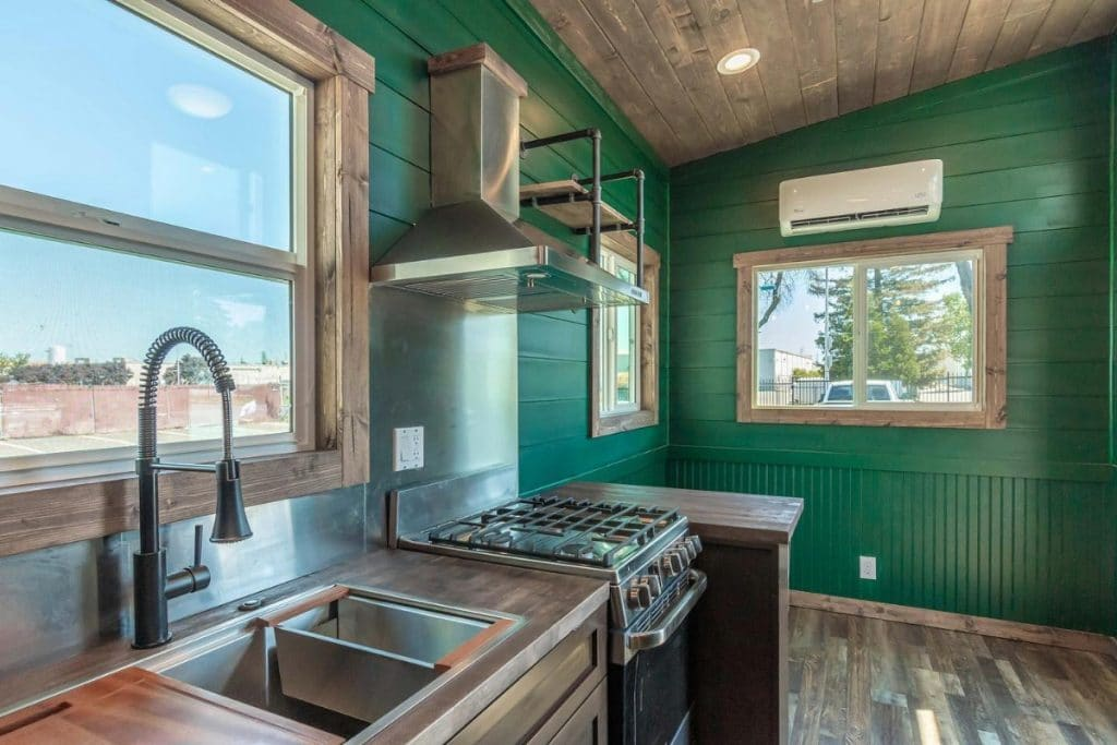 Deep stainless steel sink in tiny house by gas stove