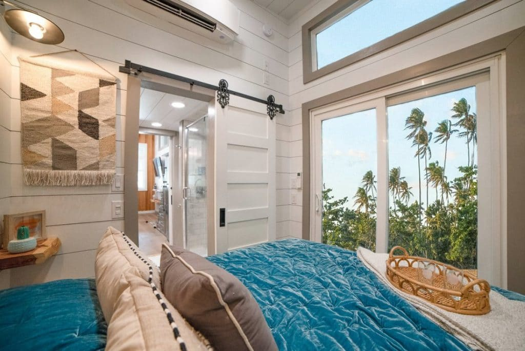 Teal blanket on bed in tiny bedroom