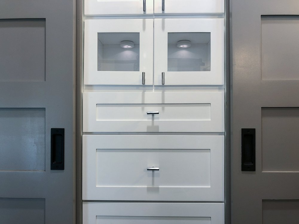 White cabinets with silver drawer and cabinet pulls