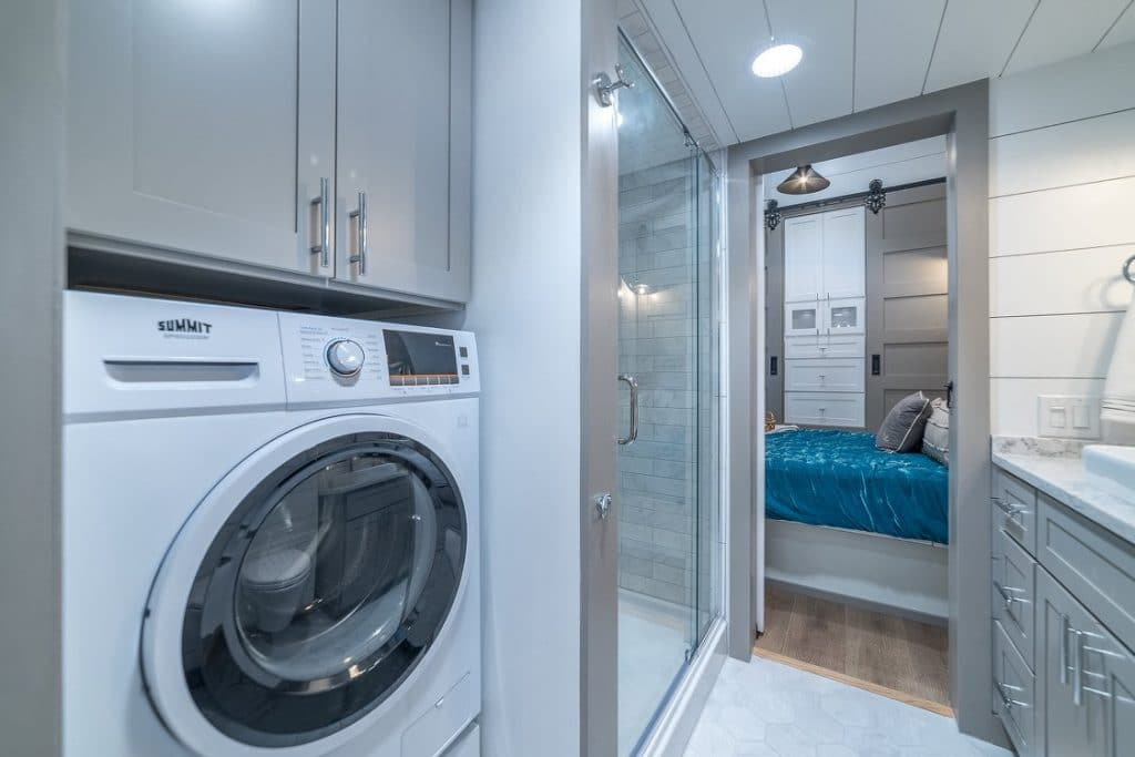 Washer dryer combination unit in white by shower