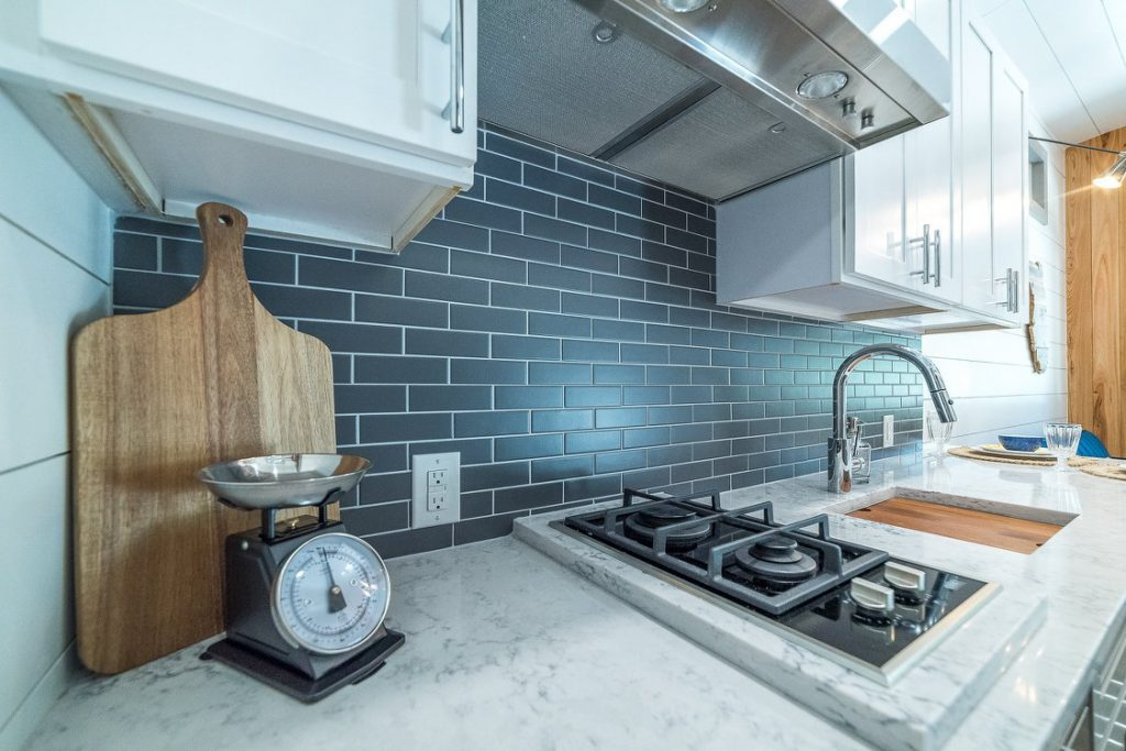 Gas cooktop in tiny kitchen with small kitchen scale
