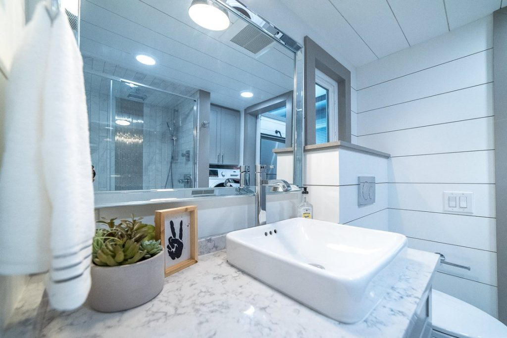 Deep white sink in bathroom with marble counter