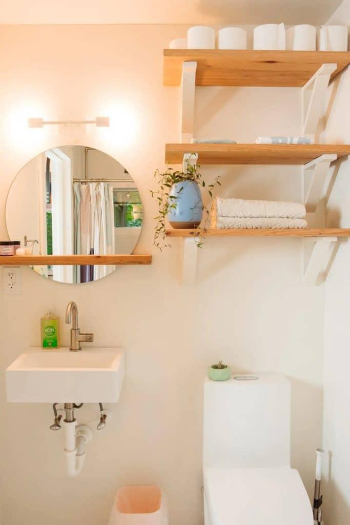 Bathroom toilet and vanity in white bathroom