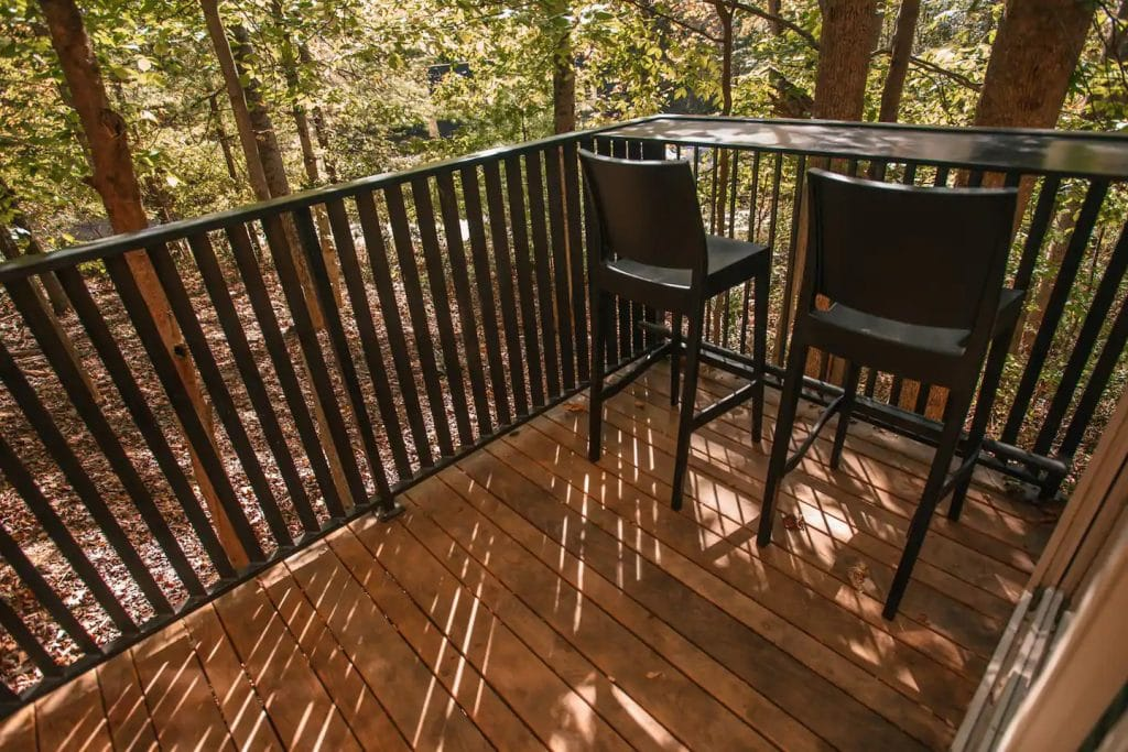 Deck with metal railing and chairs
