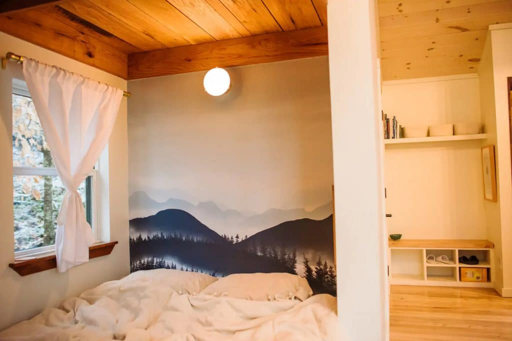 Wall mural of mountains with cushions in front