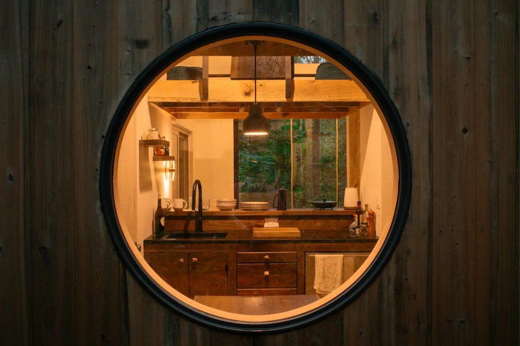 Round window view into kitchen